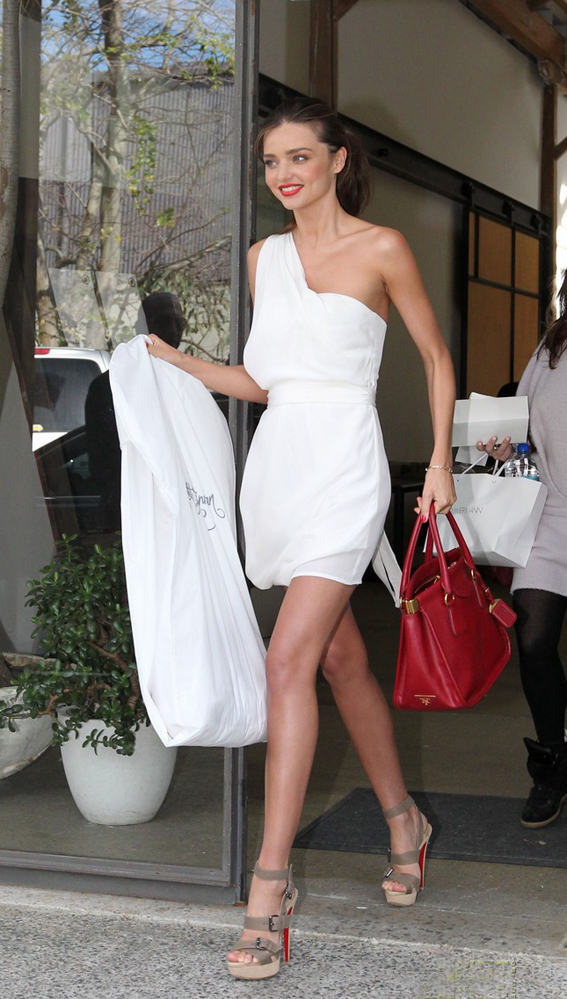 Miranda Kerr steps out in a white sexy dress